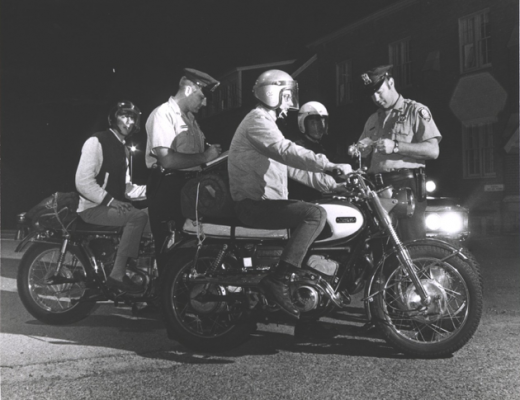 Hudson Falls Officers perform a motorcycle safety check